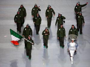 Conor Lyne of Ireland holds the national flag and enters the arena with his teammates during the opening ceremony of the 2014 Winter Olympics in Sochi