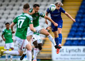 Waterford's Matthew Smith heads towards goal despite the attentions of Cork City's Alan Bennett. Photo: Sportsfile