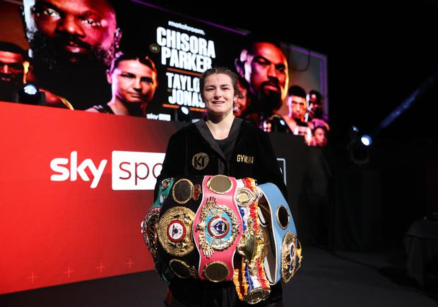 Katie Taylor with her belts after defeating Natasha Jonas in their WBC, WBA, IBF and WBO female lightweight title fight at the Manchester Arena in Manchester, England. Photo by Mark Robinson / Matchroom Boxing via Sportsfile