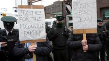Loyalist protesters gather outside Antrim police station prior to the release of Sinn Fein president Gerry Adams, in Antrim