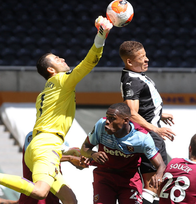 West Ham United's Lukasz Fabianski rises with Newcastle United's Dwight Gayle. Photo: Reuters