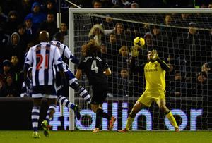 Victor Anichebe of West Brom heads in their first goal past Petr Cech of Chelsea