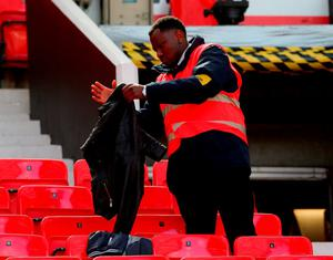 Security personnel check the stands after the game was abandoned at Old Trafford. Photo: Alex Livesey/Getty Images
