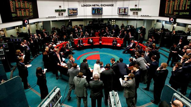 Traders and clerks react on the floor of the London Metal Exchange in the City of London in this February 14, 2012 file photo. Hong Kong Exchanges & Clearing (HKEx) is eager to wring value from its $2.2 billion purchase of the London Metal Exchange but the chances of it emulating in metals its success in connecting with stock traders on the mainland may be slipping away. Picture taken February 14, 2012.   REUTERS/Luke MacGregor/Files