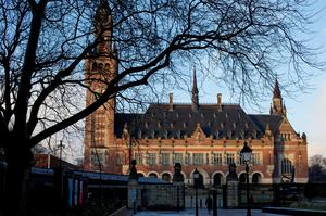 A man walks towards the International Court of Justice in The Hague, Netherlands. (AP Photo/Peter Dejong)
