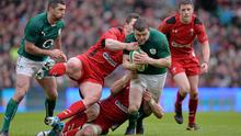 Ireland centre Brian O'Driscoll is tackled by Wales pair Sam Warburton and George North