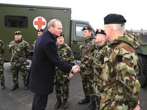 Defence Minister Simon Coveney, shaking hands with Cpl Pierce Foley, and accompanied by Brigadier General Kieran Brennan, General Officer Commanding 1 Brigade, before the troops are deployed to Sierra Leone.