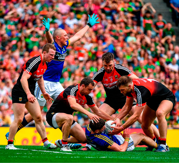 Kerry's Kieran Donaghy in protest as team-mate Paul Geaney is bundled to the ground by a combination of Mayo's (from left) Colm Boyle, Keith Higgins, Séamus O'Shea and Aidan O'Shea. Photo by Ramsey Cardy/Sportsfile