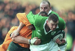 David Corkery shows his determination as he powers through the tackle of Australia's George Gregan, ably supported by Keith Wood, during a November international at lansdowne Road back in 1999