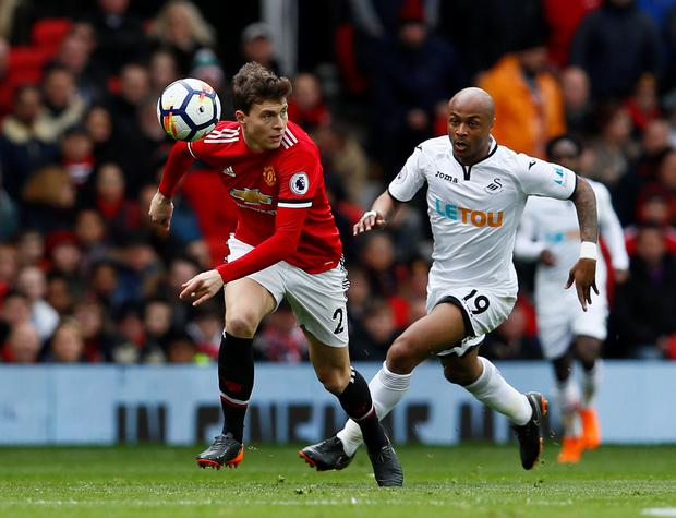 Manchester United's Victor Lindelof races ahead of Swansea City's Andre Ayew. Photo: Reuters