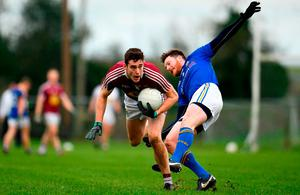 Sam Duncan of Westmeath in action against Michael Quinn of Longford during the Bord na Mona O'Byrne Cup semi-final match between Westmeath and Longford at Downs GAA Club in Westmeath. Photo by Sam Barnes/Sportsfile