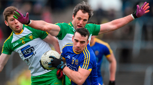 Roscommon's Thomas Featherston holds off Eoghan Ban Gallagher (left) and Michael Murphy during their defeat to Donegal Photo: David Maher/Sportsfile