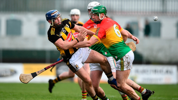 Ger Aylward of Kilkenny in action against David English of Carlow. Photo by David Fitzgerald/Sportsfile