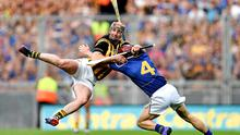 Kilkenny's Eoin Larkin and Paddy Stapleton of Tipperary battle for possession during this year's drawn All-Ireland final
