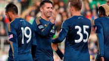 Robbie Keane congratulates his LA Galaxy teammate Mika Varynen after he scored their side's winning goal in their friendly with Shamrock Rovers at Tallaght Stadium. Photo: David Maher / SPORTSFILE
