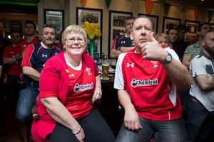 Welsh fans Beth-Anne and Derek Roberts from Carnarvon, Wales watch the Wales v Ireland rugby match at Searsons, Baggott Street yesterday. Photo: Tony Gavin 14/3/2015