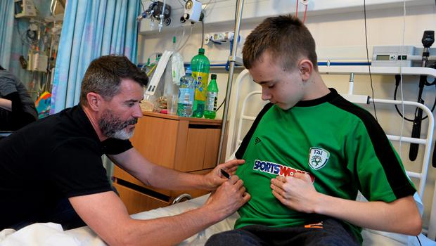 11 June 2015; Republic of Ireland manager Martin ONeill and assistant manager Roy Keane took time out of their busy preparation for Saturdays must win qualifier against Scotland to make a very special visit to Temple Street Childrens University Hospital today, where they met brave little patients, along with their parents and staff. The Irish legends made the visit in conjunction with the SportsWorld FAI Summer Soccer Schools, who earlier this year announced Temple Street as their charity of the year. SportsWorld, part of the Heatons department store group, are delighted to be title sponsor of the FAI Summer Soccer Schools. You too can support Temple Street Childrens Hospital by donating 1 when you book your camp online at www.summersoccerschools.ie. Pictured are Republic of Ireland assistant manager Roy Keane with Jack Kelly Smyth, age 14, from Kilmainhamwood, Co. Meath. Temple Street Hospital, Dublin. Picture credit: David Maher / SPORTSFILE
