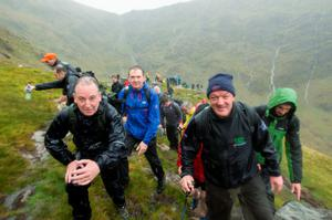 Former Irish rugby player Mick Galwey with Journalist Paul Williams and Editor in Chief of Independent news and Media Stephen Rae  climbing Carrauntoohill for the Caps to the Summit in aid of the Alan Kerins in partnership with Gorta self help Africa. Pic:Mark Condren