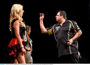 26 March 2015; Adrian Lewis competes against Dave Chisnall during the Betway Premier League Darts at the 3Arena, Dublin. Picture credit: Stephen McCarthy / SPORTSFILE