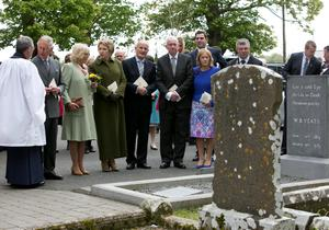News 20052015. No Repro Fee The Prince of Wales and The Very Revd Dean Arfon Williams at the grave of WB Yeats after attending a  Service for Peace and Reconciliation at St. Columba's Church Drumcliff , Sligo on the second day their visit to the west of Ireland.  Photo Chris Bellew / Copyright Fennell Photography 2015