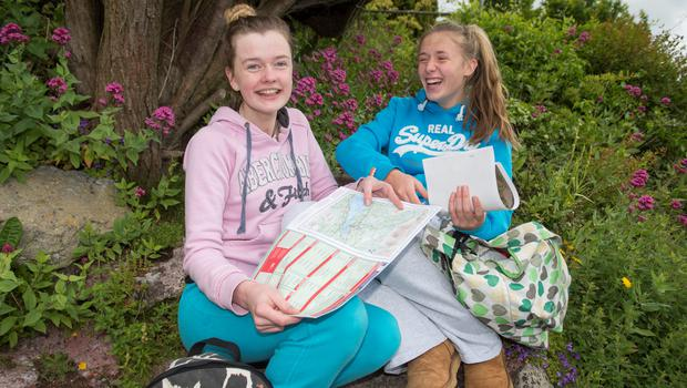 Grace Filen and Kelly Diggin after sitting their Leaving Cert Geography exam at St Angela's College, Cork. Photo: Michael Mac Sweeney, Provision