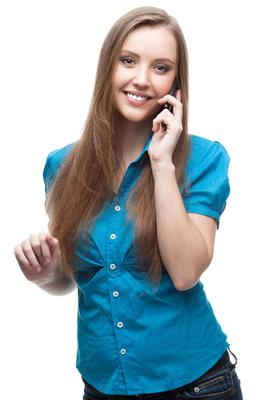 Walking while you talk on the phone is a great way to add movement to your day (stock photo)