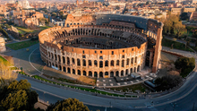 Running on empty: An aerial photo taken last Tuesday shows deserted streets and the Colosseum in Rome during Italy's lockdown. Photo: Elio Castoria/AFP via Getty.