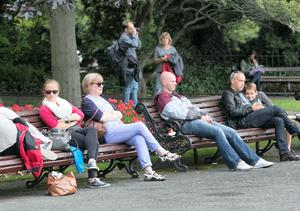 People enjoying the good weather in St. Stephens Green, Dublin