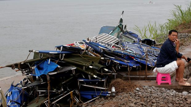 Stretchers are seen near the capsized Eastern Star in the Jianli section of Yangtze River, Hubei province, China, June 7, 2015. REUTERS/Kim Kyung-Hoon