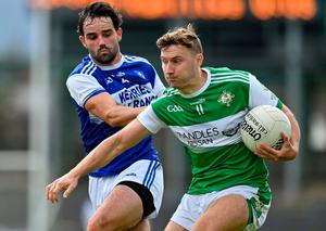 Legion's James O'Donoghue is tackled by Kerins O'Rahilly's Cormac Coffey