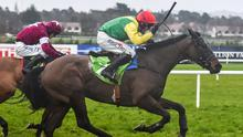 Sizing John, with Robbie Power up, races ahead of Don Poli and David Mullins during the Stan James Irish Gold Cup at Leopardstown. Photo: Cody Glenn/Sportsfile