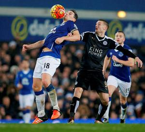 Leicester's Jamie Vardy competes for possession with Everton's Gareth Barry. Photo: Phil Noble/Reuters