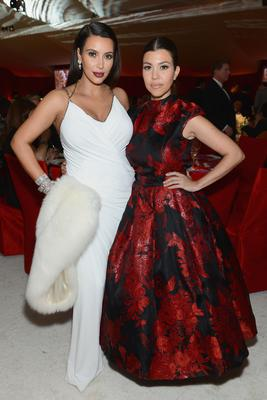 (L-R) TV Personalities Kim Kardashian and Kourtney Kardashian attend the 21st Annual Elton John AIDS Foundation Academy Awards Viewing Party at West Hollywood Park on February 24, 2013 in West Hollywood, California.  (Photo by Dimitrios Kambouris/Getty Images for EJAF)
