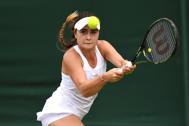 Gabriella Taylor of Great Britain plays a backhand during the Girl's singles first round match against Morgan Coppoc of The United States on Middle Sunday of the Wimbledon Lawn Tennis Championships at the All England Lawn Tennis and Croquet Club on July 3, 2016 in London, England. (Photo by Shaun Botterill/Getty Images)