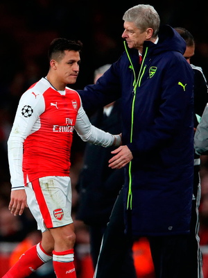 Arsenal's Alexis Sanchez walks by manager Arsene Wenger after being substituted during matchl. Photo: Nick Potts/PA