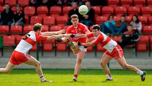 Cork's Enda Lynn in action against Derry duo Liam McGoldrick and Daniel Heavron
