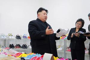 North Korean leader Kim Jong Un (L) provides field guidance to the Ryuwon Shoes Factory in this undated photo released by North Korea's Korean Central News Agency (KCNA) in Pyongyang