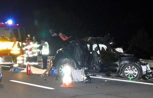 Emergency services attend the scene of a crash involving a car belonging to All Blacks rugby player Jerry Collins on the highway near Beziers, southern France