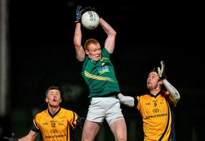 Ciaran McConnell, Meath, in action against Diarmuid O'Connor and Eoin O'Connor, DCU
