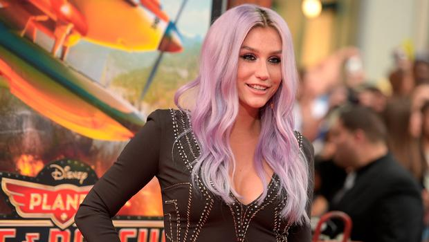 """Singer/songwriter Kesha attends the premiere of Disney's """"Planes: Fire & Rescue"""" at the El Capitan Theatre on July 15, 2014 in Hollywood, California.  (Photo by Jason Kempin/Getty Images)"""