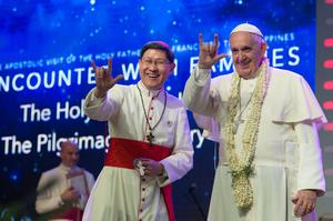 Pope Francis gestures to the crowds in Manila yesterday. He has spoken out on how free speech comes with responsibility in the wake of the 'Charlie Hebdo' massacre.