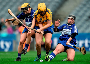 Roscommon's Niamh Farrell fights off Mairead Burke, left, and Laura Dunne of Laois