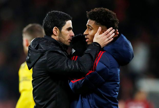 Arsenal manager Mikel Arteta speaks with Reiss Nelson at full-time. Photo: REUTERS/Eddie Keogh