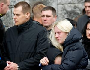 Parents Vidas and Aukse with daughter Agnita pictured at the funeral of Vakaris. Photo: Provision