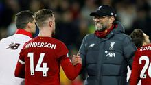 Liverpool manager Jurgen Klopp celebrates with Jordan Henderson after the 1-0 win over Norwich. Action Images via Reuters/John Sibley