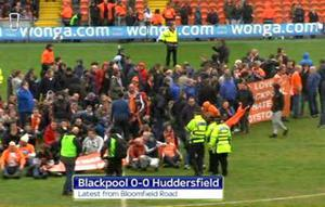 Blackpool fans stage a protest during the final Championship game of the season