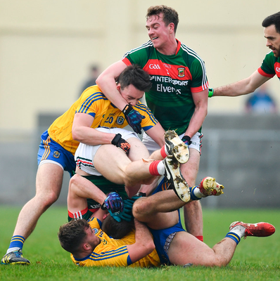 Mayo duo Conor O'Shea (below) and Danny Kirby tussle with Ultan Harney (below) and John McManus of Roscommon.  Photo: Ramsey Cardy/Sportsfile