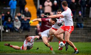 Damien Comer is tackled by Liam Rafferty, left, and Ronan McNamee of Tyrone resulting in a penalty. Photo: David Fitzgerald/Sportsfile
