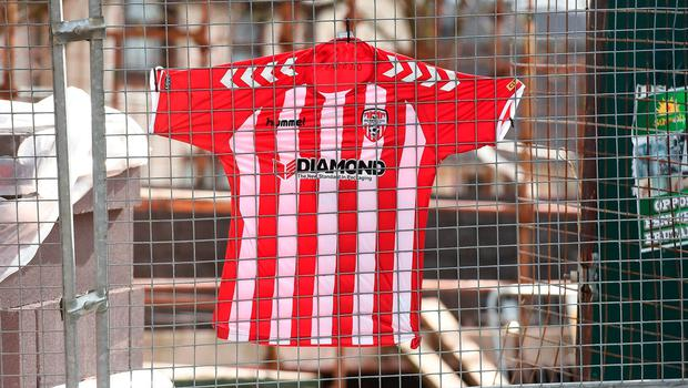 A Derry City FC jersey is pinned to the fence outside the Brandywell Stadium to pay tribute to the late Derry City captain Ryan McBride, who passed away suddenly. Photo: Oliver McVeigh/Sportsfile