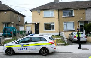 Gardai at the Finglas house after the first shooting incident